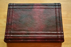 We've already completed this plain leather covered book.  Next stop, decoration!